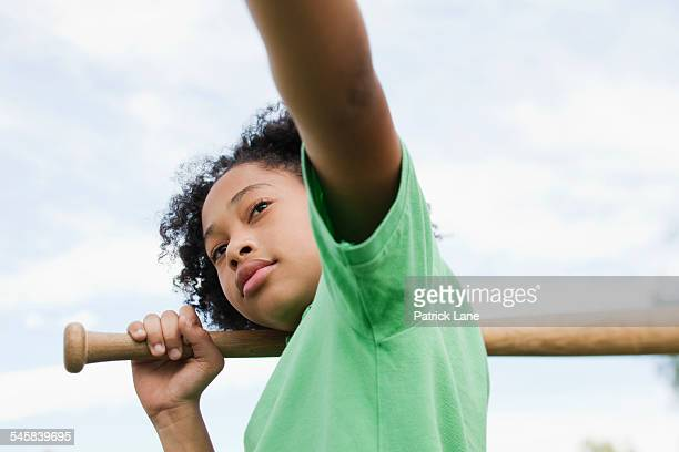 girl (10-12) holding baseball bat - batting sports activity stock pictures, royalty-free photos & images