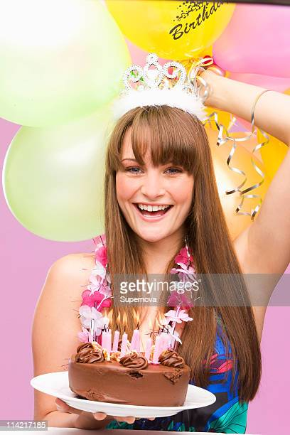 Girl holding birthday cake, Cape Town, Western Cape Province, South Africa