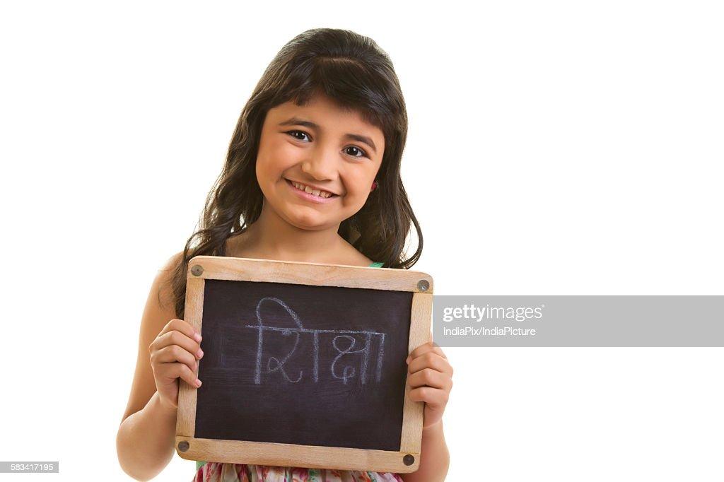 Girl holding black board : Stock Photo