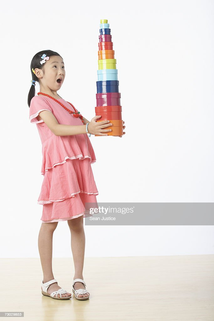 Girl (6-8) holding blocks : Stock Photo