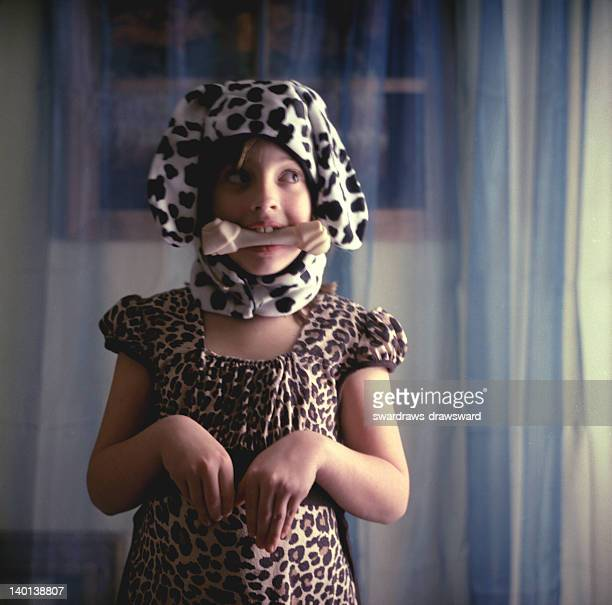 girl holding bone in mouth - animal representation stock pictures, royalty-free photos & images