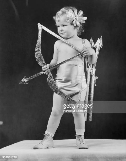 Girl holding bow and arrow