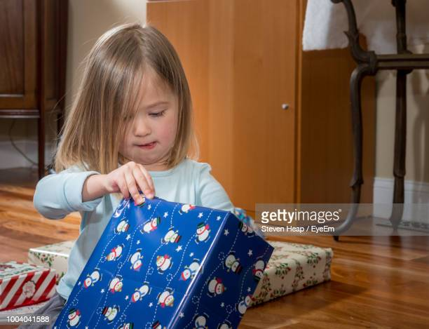 Girl Holding Box At Home