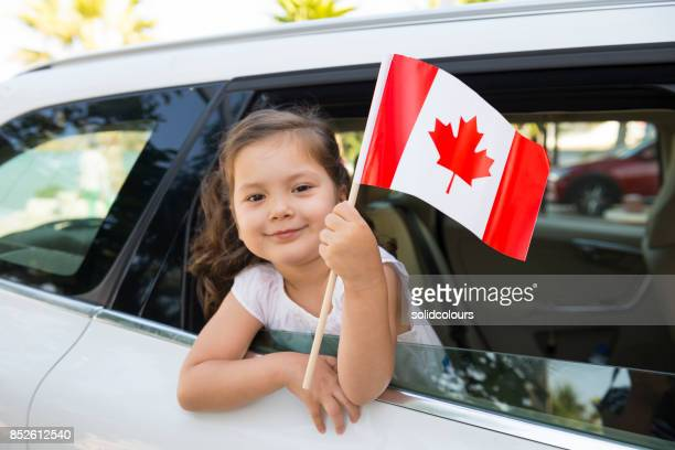 girl holding canadian flag - canadian flag stock pictures, royalty-free photos & images