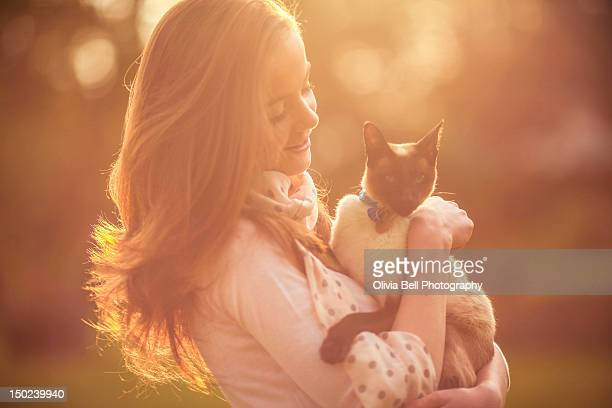Girl holding cat in arms