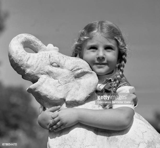 girl holding ceramic elephant - constance bannister stock photos and pictures