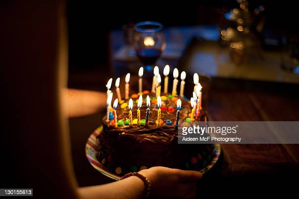 girl holding chocolate cake - birthday cake stock photos and pictures