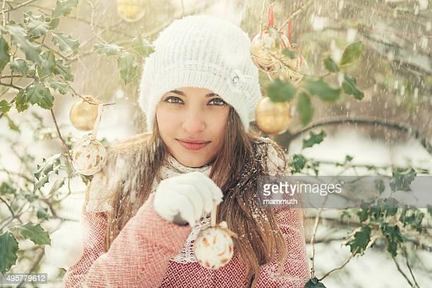 girl holding christmas ball