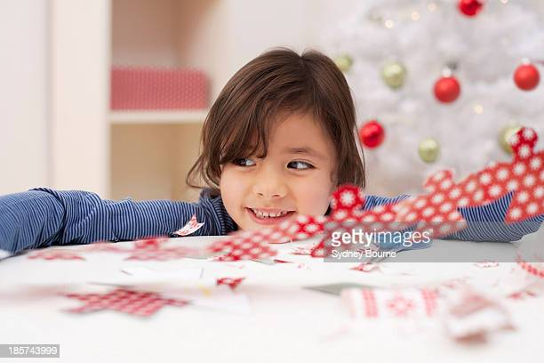 Girl holding Christmas decoration,  smiling
