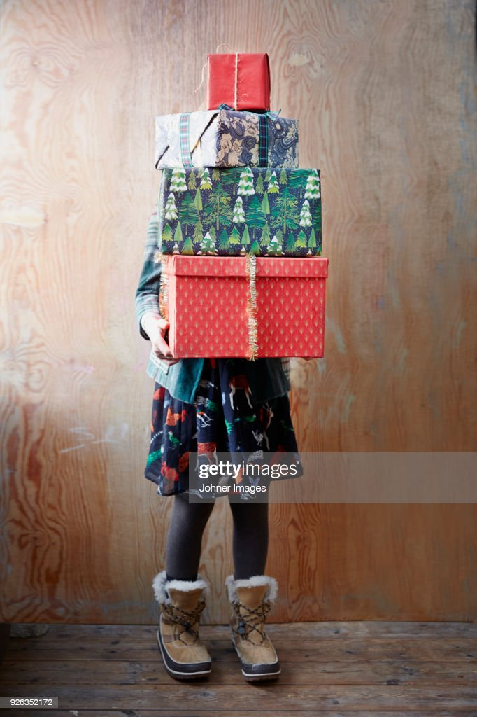 Girl holding Christmas presents : Stock Photo
