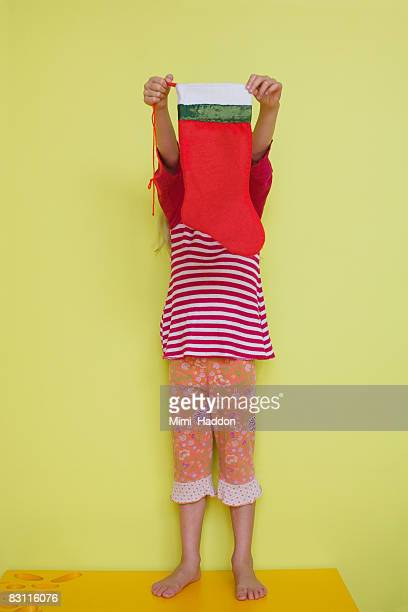 Girl holding Christmas stocking