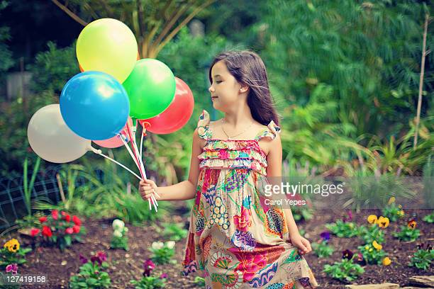 girl holding colorful balloons - multi coloured dress stock pictures, royalty-free photos & images