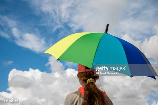 girl holding colourful umbrella - morpeth stock pictures, royalty-free photos & images