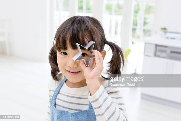 Girl Holding Cookie Cutter