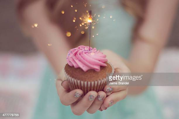 Girl Holding Cupcake with Sparkler