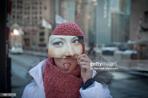 Girl holding cutout face