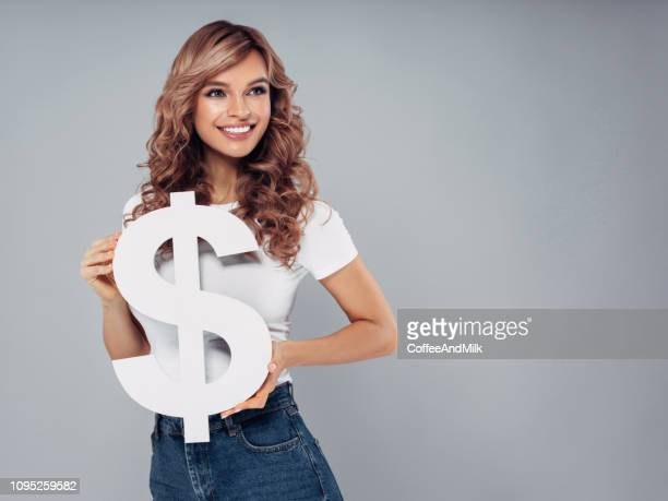 Girl holding dollar symbol