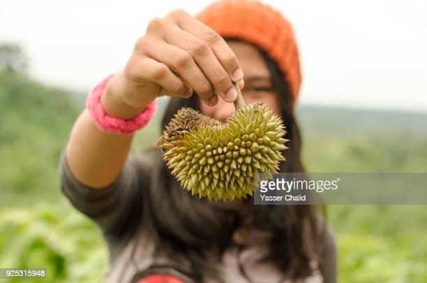 Girl Holding Durian