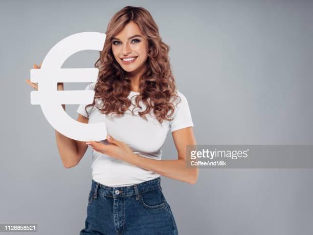 Girl holding euro symbol