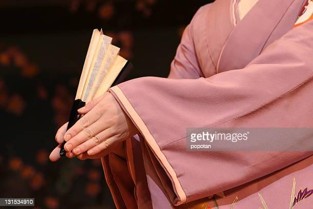 Girl holding fan