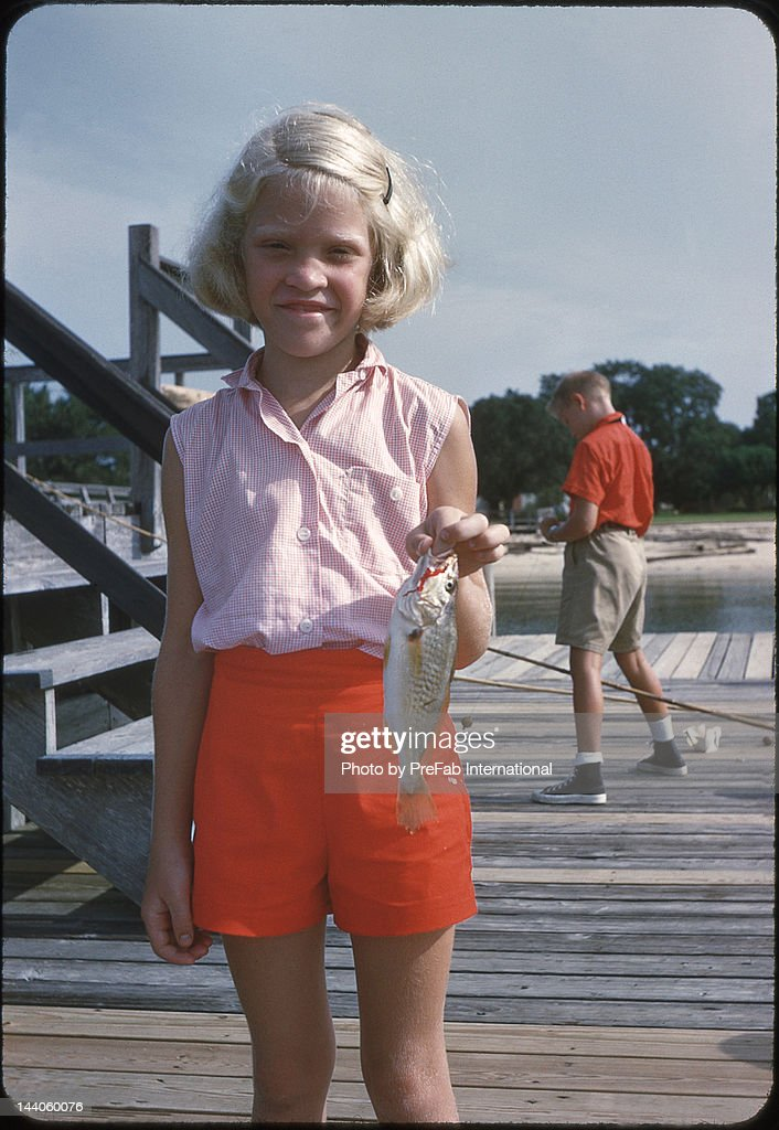 Girl holding fish in hand : Stock Photo