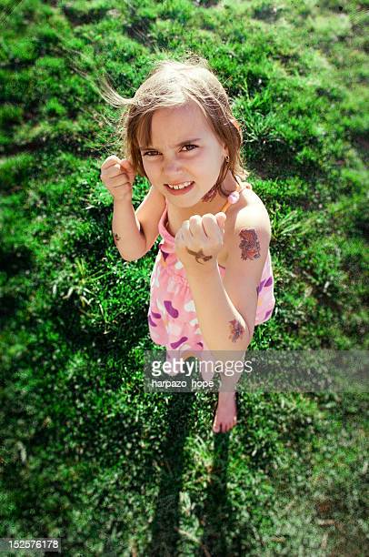 girl holding fists up - temporary stock pictures, royalty-free photos & images