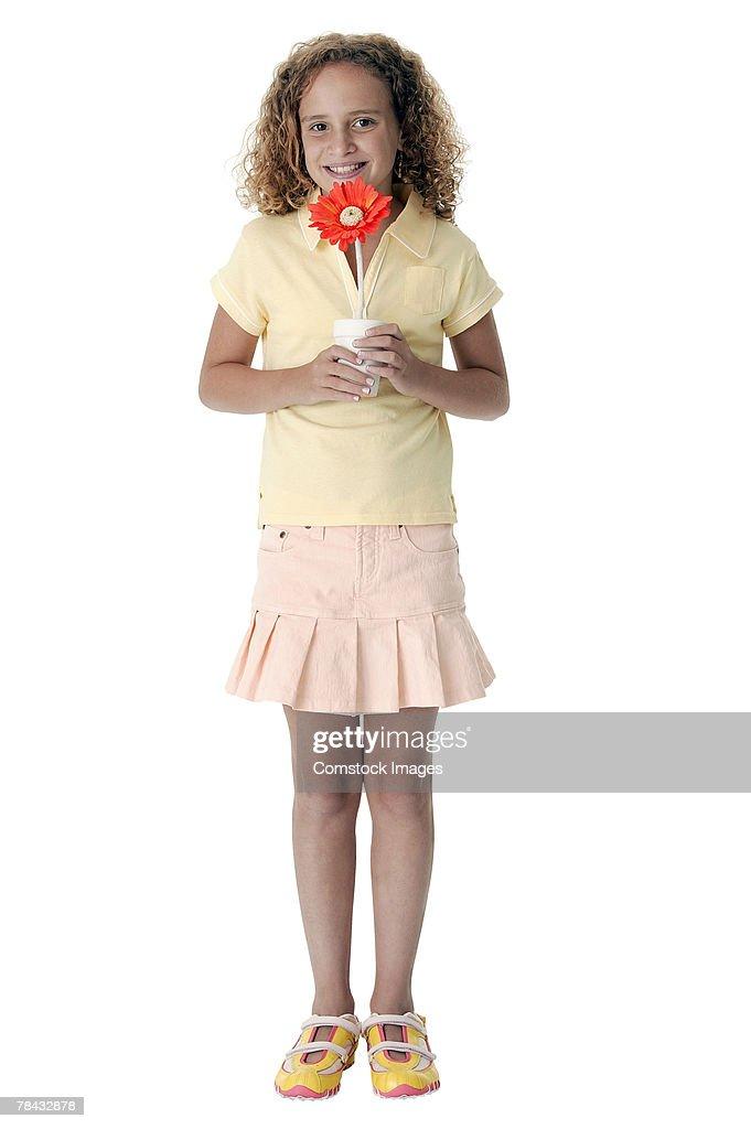 Girl holding flower : Foto de stock