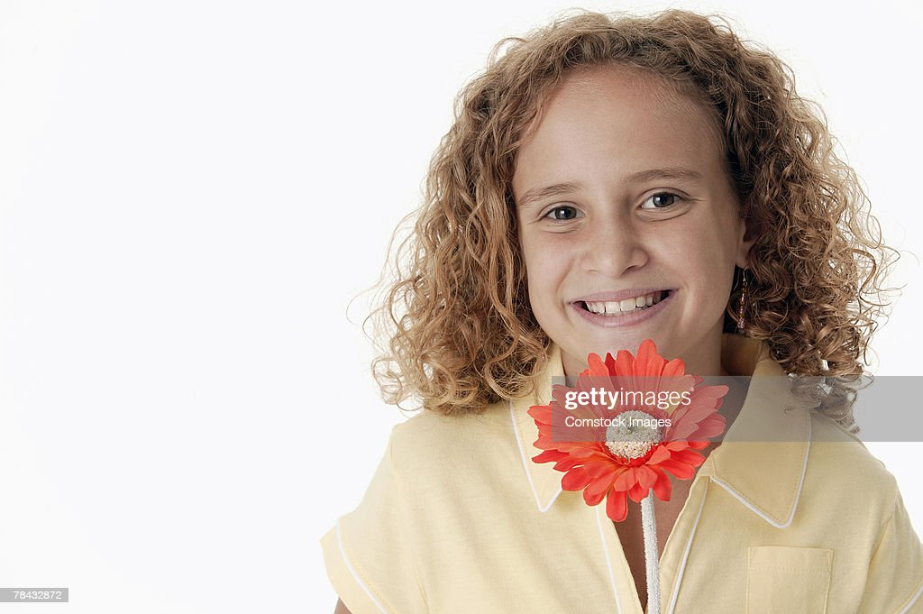 Girl holding flower , portrait : Stockfoto