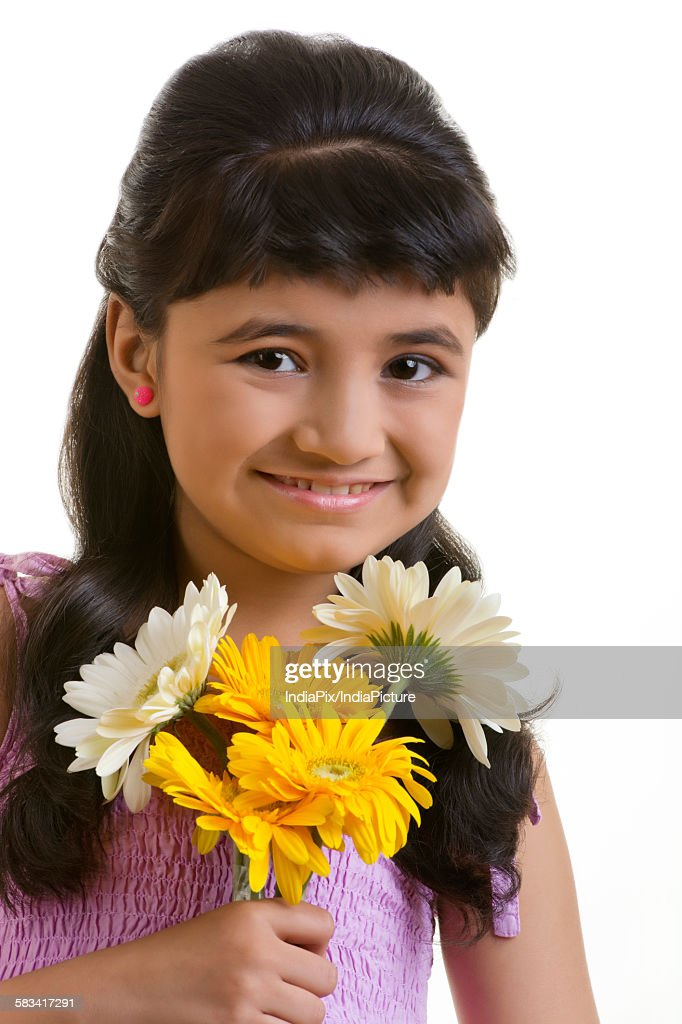 Girl holding flowers : Stock Photo