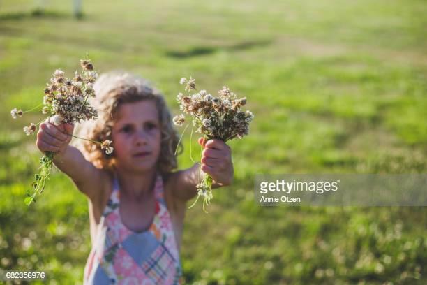 Girl Holding Flowers She Picked