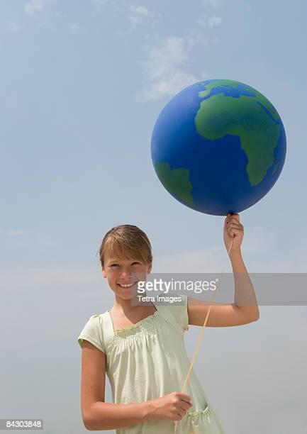 Girl holding globe balloon