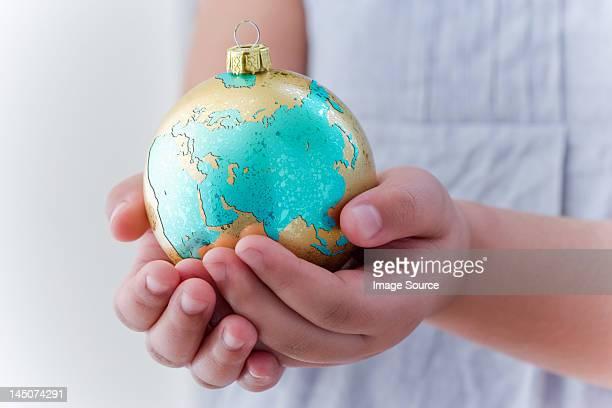 Girl holding globe decoration