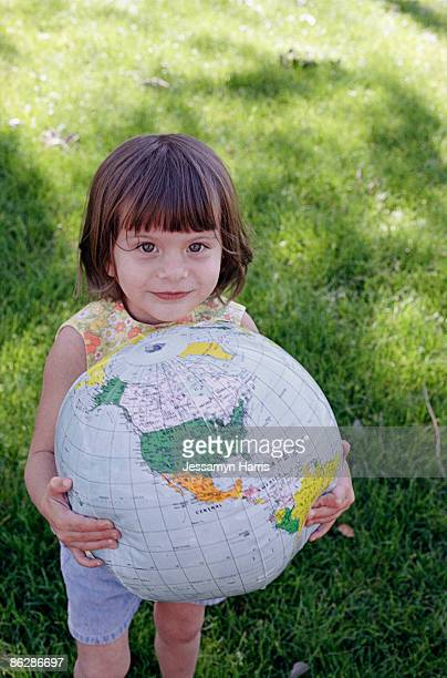 girl holding globe - jessamyn harris stock pictures, royalty-free photos & images