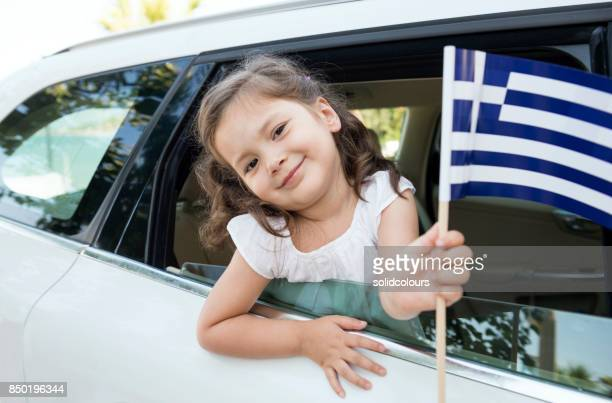 girl holding greece flag - greek flag stock pictures, royalty-free photos & images