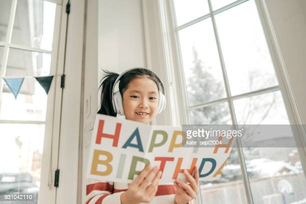 Girl holding greeting card
