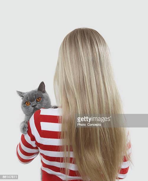 Girl holding grey cat