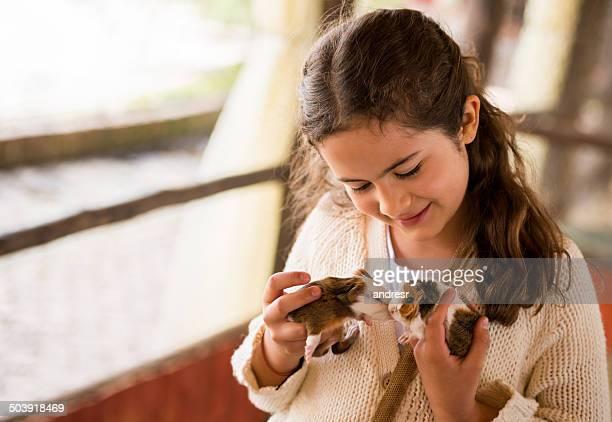 Girl holding guinea pigs
