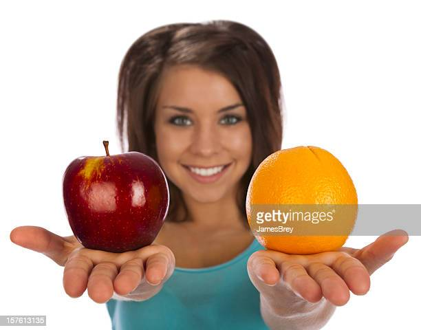 Girl Holding Healthy Fruit Choices; Apple, Orange