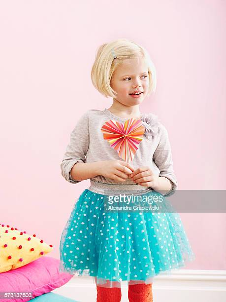 girl holding heart shaped fan at heart - little girls up skirt stock pictures, royalty-free photos & images
