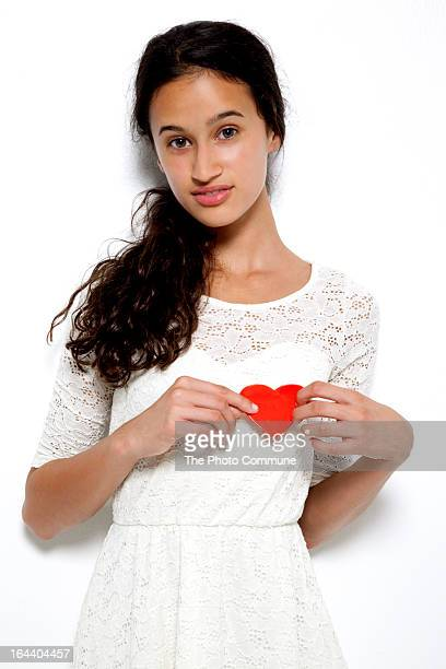 girl holding heart to chest looking at  camera - girl chest stock photos and pictures