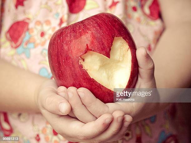Girl Holding Heart-Shaped Apple
