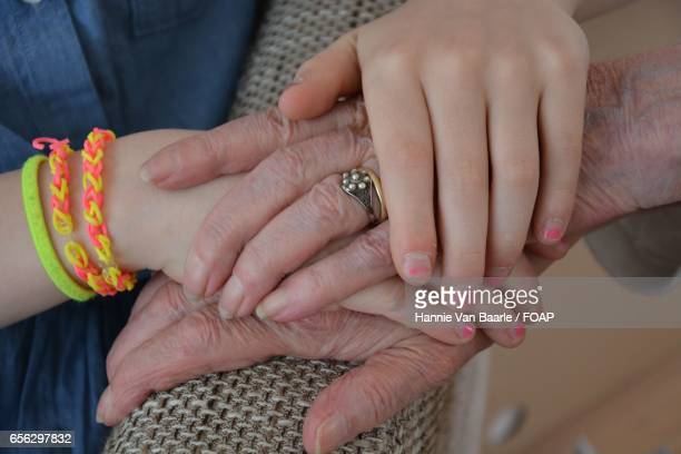 Girl holding her grandmothers hand