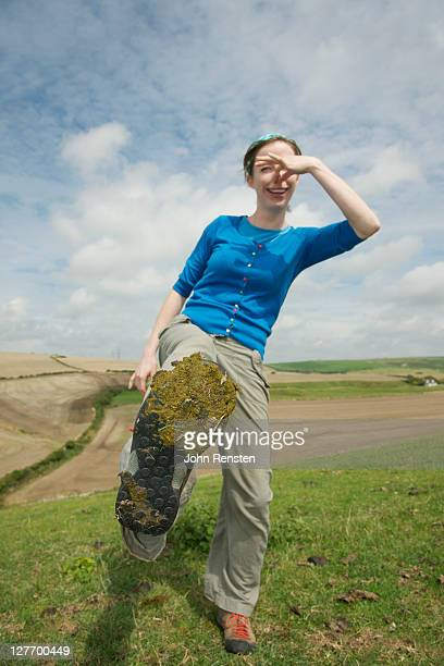 Girl holding her nose having stood in dung