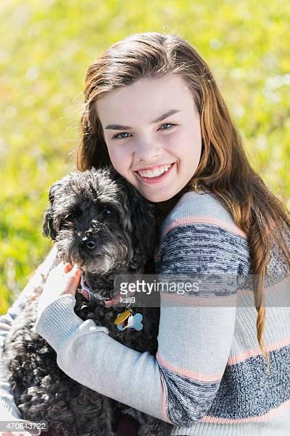 Girl holding her pet dog