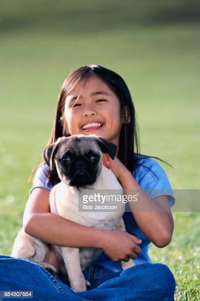 Girl Holding Her Pet Pug