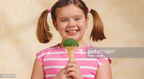 Girl holding ice-cream cone broccoli