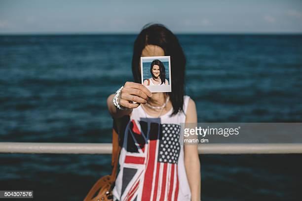 Girl holding instant photo selfie