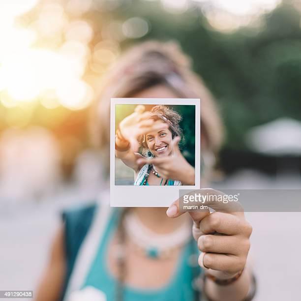 Girl holding 、ポラロイド写真を