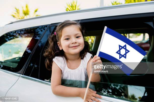 girl holding israel flag - israel flag stock pictures, royalty-free photos & images
