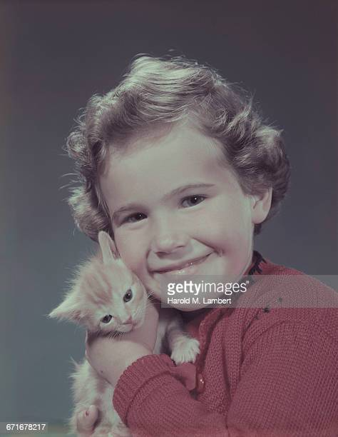 girl holding kitten  - pawed mammal stock pictures, royalty-free photos & images